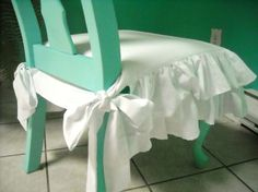 Love this style of chair cover but maybe in linen so it doesn't look so frilly.