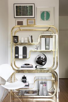 Milo Baughman for DIA brass etagere.   Those curves are mesmerizing-- beautiful and utilitarian.