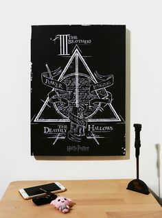 """The Tale of the Three Brothers may seem like a children's story to teach humility and wisdom to some, but it's the key to unlocking The Deathly Hallows to others. This canvas print is the perfect thing to hang in your home or office to denote yourself as a believer.<div><ul><li style=""""list-style-position: inside !important; list-style-type: disc !important"""">13"""" x 18""""</li><li style=""""list-style-position: inside..."""
