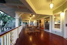 You can use wood flooring as long as the roof eaves protrude at least 4 ft.