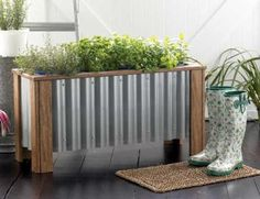 Fresh Home Planter Box from lumber and corrugated roofing. Plans and tutorial at the link.