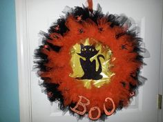 Halloween Wreath. I made this wreath with a wire wreath frame, tulle, foam and plastic spiders and glitter.