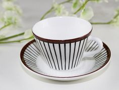 This is an original Spisa Ribb design Demitasse Cup and Saucer, mfr by Gustavsberg, Sweden and designed by Stig Lindberg in 1955.