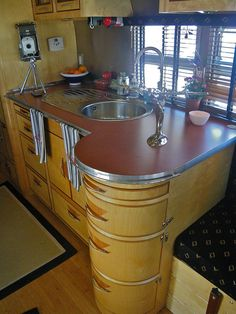 love the shape of the sink and cabinets