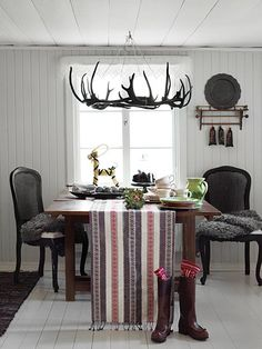 Love the reindeer chandelier and the runner and the Jul Bok and. Antler Light Fixtures, Goth Home, Pergola Attached To House, Scandinavian Design, Nordic Design, Humble Abode, Table And Chairs, Christmas Home, Horn