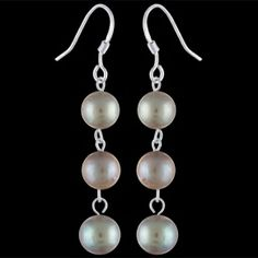 Silver earrings, pearls Silver earrings, Ag 925/1000. Elegant earrings consist of three pearls connected by fine links. Rhodium-plated. Diameter of pearl approx. 7 mm. Dangle earrings. Price per pair.