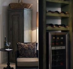 Love this wine cabinet that holds both bottles on its shelving and a wine cooler. I need this in my dining room!