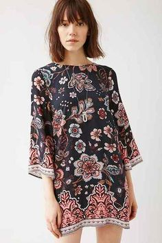 Mini shift dress with 3/4-length bell-sleeves by the modern-boho masters at Ecote. In an intricate print with banded patterns at the hems, cut boxy + short with a crew-neck. Finished with a plunging V cut out at the back. #blueroofind