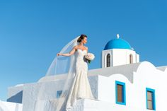 A luxury wedding in Santorini at Le Ciel.  The beautiful Lily Married the handsome Lee in this gorgeous elegant affair.  #leciel #luxurywedding #santorini #phosart #weddingsabroad #destinationwedding