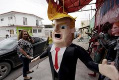 A Mexican client who lives in the U.S., looks at a pinata depicting U.S. Republican presidential candidate Donald Trump hanging outside a workshop in Reynosa, Mexico, June 23, 2015. Days after billionaire Trump accused Mexico of sending criminals to live in the United States, a Mexican artisan has given angry Mexicans an outlet-- a Trump pinata they can stuff with candy and beat with a stick. In the Mexican border city of Reynosa, Dalton Ramirez works at his family's pinata shop where they c...