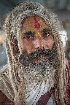 A sadhu, or a holy man seen at a railway station enroute Jaipur in Rajasthan, India