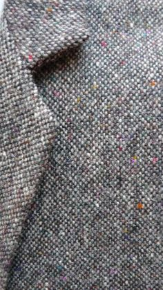 "Donegal Tweed suit woven in wool with different texture to Harris Tweed. Originally the making of this fabric was a ""home"" industry and the coloured dyes were made of plant materials gathered in the area of Donegal, Ireland."