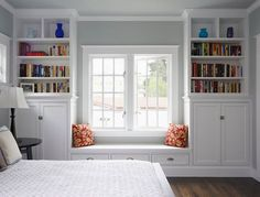 built in shelves around window...love the fabric on the cushion! Would love this around the picture window in my living room!