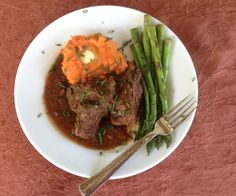 Succulent and tender, paleo smothered short ribs are cool-weather comfort food, and the sweet potatoes are spiked with tangerine for bright flavor. #chowstalker