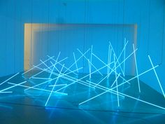 It's installation art by François Morellet. In his pieces he used all kinds of different materials – neon tubes, pieces of wood, adhesive tape on walls, ..