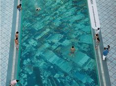 ECO ART ACTIVISM: Swimming Above a Submerged City | Talk about subliminal advertising. HSBC Bank hired advertising agency Oglivy & Mather in Mumbai to create a campaign for their website, www.globalwarmingsolutions.co.in, designed to call the public's attention to the reality of global warming. The campaign entailed placing a bird's eye view of New York City's skyline at the bottom of a pool located in India's financial capital, Mumbai.