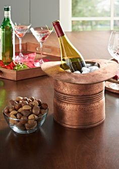 Add instant good cheer to your celebrations with our Copper Top Hat Wine Cooler.