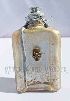 Halloween Potion Bottle Silver Small, Witches Kitchen Skull, Cork top w/ Twine neck and Silver wax Drippings Halloween Potion Bottles, Witch Potion, Metal Skull, Kitchen Witch, Glass Bottles, Twine, Wax, Things To Sell, Image
