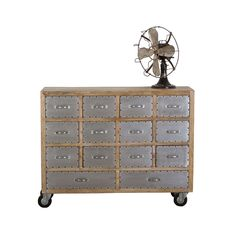 Your living space won't be lacking in interest, structure, or storage space with the Hugo Industrial Dresser. The mix of hard metal and soft, natural wood complements this 14-drawer dresser and adds a unique charm to your bedroom space.