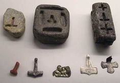 Viking Age molds for making silver pendants--Crucifixes & Mjolnir (Thor's Hammer). The far right mold could be used for making either depending on the customer. Mjolnir pendants only became popular to compete with the crosses worn by those with the new religion at the spread of Christianity. source