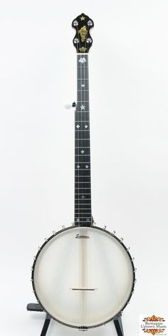"""A recreation of the 1903 A. C. Fairbanks Whyte Laydie No. 2. It is made directly from an extant example and mimics the original in every way with the exception of geared tuners. This banjo is a project that has been three years in the making. The banjos are made by Eastman Strings, Inc. exclusively for Bernunzio Uptown Music. The rim is light weight, 3/8"""" thick and 10-3/4""""in diameter. The scale length is 26"""". All of the materials are as per original with maple neck and rim and ebony…"""