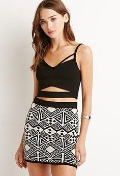PEDIDOS SOLO POR ENCARGO Código: F-57 Geo-Patterned Mini Skirt Color: Black/taupe Talla: S-M-L Precio: ₡21.500 ($39,81)  Información y consulta llamar 8963-3317, escribir al inbox o maya.boutique@hotmail.com.  Envíos a todo el país.