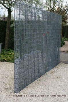 Some innovative ideas on display at Appeltern Gardens, such as this hardware cloth metal mesh gabion-like fence, or perhaps it's a wall, partially filled with trap rock. -- BelleWood-Gardens - Diary by tonia Fence Design, Garden Design, House Design, Wall Design, Landscape Architecture, Landscape Design, Gabion Baskets, Gabion Wall, Gabion Fence Ideas
