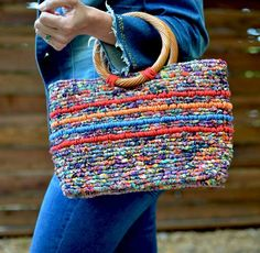 Locker hook an easy to make confetti tote bag in vibrant colors with hand-dyed fabric strips and jute twine, and download a free pattern.