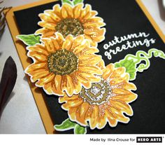 close-up view of stamped sunflowers from Creativity Within  ... layered stamping ... top layer shows clear heat embossing over the color ... luv how it adds shine and dimension to the flowers ....