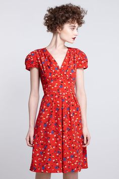 With a little sleeve altering and midriff re-drawing, I think Simplicity 1801 would knock this off perfectly! http://www.simplicity.com/p-7500-misses-dresses-cynthia-rowley-collection.aspx