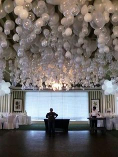 Beautiful idea for a wedding reception. Place a marble in each balloon before blowing up so they hang upside down.