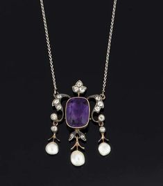 A LATE 19TH EARLY 20TH CENTURY AMETHYST, DIAMOND AND PEARL PENDENT NECKLACE The central cushion shaped amethyst in collet mount between old-cut diamond scrolls, suspending three pearl drops, with trefoil cluster surmount, to a trace link neckchain, circa 1900,