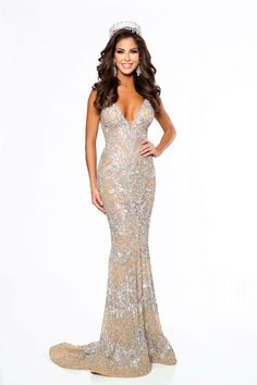 Nancy Gonzalez punched her ticket to Miss USA 2017 after she captured the title of Miss Texas USA 2017 in this visually striking nude evening gown!  The Color -   The color of this evening gown is well offset by the silver crystal detailing throughout the gown. Without the detailing ,the nude color itself would not have been as show stopping.  The nude and silver color combination complements Nancy's dark hair and tan complexion wonderfully.
