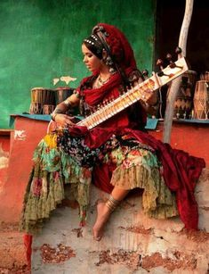 woman playing the sitar in India