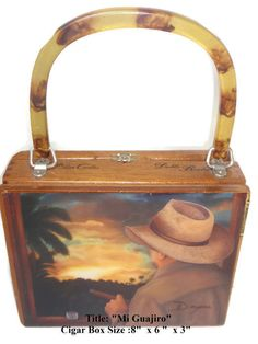 The most popular handbag cigar box purses in Florida. Made with original cigar boxes and embellished with beautiful art. These handmade cigar box purses have bamboo, plastic or wood handles. Acrylic surface with super glaze. Cigar Box Purse, Cigar Boxes, Cigar Box Crafts, Cigar Art, Good Cigars, Popular Handbags, Cuban, Valentine Gifts, Cool Art