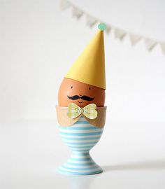Using an ink pen and a simple paper hat!   Great Easter Eggs!