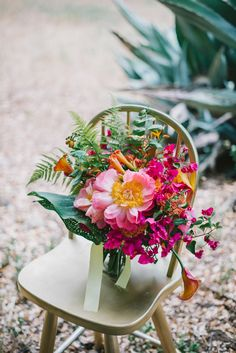This colorful bouquet, designed by Molly Ryan Floral, showed off coral charm peonies, mango cala lilies, sunset-colored roses, orange dahlias, trumpet vine and bougainvillea; it felt like happiness. It had a wild, loose, and natural style. #wedding #weddingflowers #florals
