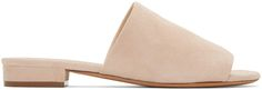 Suede slip-on sandals in 'sand' beige. Open round toe. Covered block heel. Leather sole in tan. Tonal stitching.