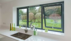 reports local double glazing installers offer the best prices on replacement windows. Get up to four double glazing quotes from local suppliers Grey Windows, Casement Windows, House Windows, Grey Window Frames, Kitchen Windows, Aluminium Windows And Doors, Sliding Windows, Aluminium French Doors, Double Doors Exterior