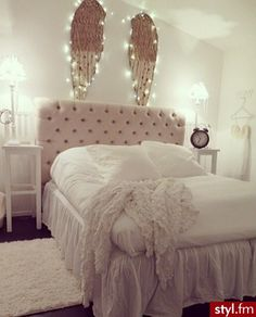 Love the angel wings above the bed