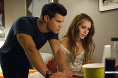 Taylor Lautner and Lily Collins looking at the site of missing kids in Abduction :)