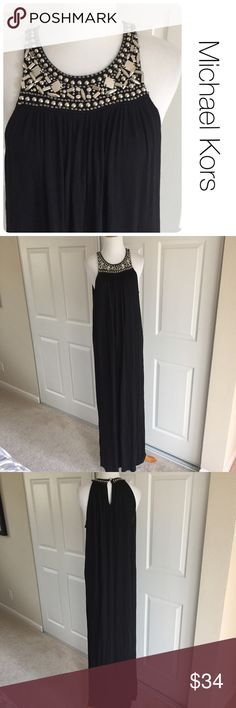 MIchael Kors black maxi dress size M ♦️Excellent condition. No holes, stains or piling.                                                 ♦️Materials- 100 rayon                         ♦️Measurements:                                                ♦️Laying flat armpit to armpit: approximately 18 inches                       ♦️Laying flat from the back of the neck to the bottom of the front hem is approximately 56 inches Dresses Maxi