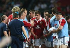 Owen Farrell of the Lions is surrounded by team mates during the match between the British & Irish Lions and the Barbarians at Hong Kong Stadium on June 1, 2013,  Hong Kong.