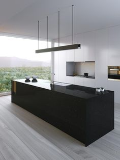 Nice black and white contrast with long clean lines in this modern kitchen