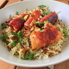 "Herby Cauliflower Rice with Pecans and Candied Bacon-Wrapped Chicken | ""Bacon-wrapped chicken with brown sugar and chili powder is baked next to cauliflower rice in this easy sheet pan dinner ready in about an hour."""