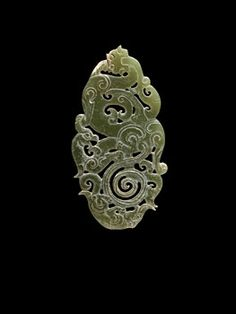 China, Plaque Ornament of a Serpentine Tiger with Spiral Tail, a Bear, and a Feng Bird, Han Dynasty, 206 BCE - 220 CE. Jade