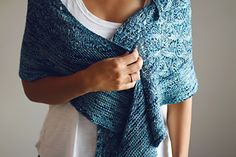 This is an asymmetrical shawl with a lace body and an irregular garter stitch border. Worked in DK weight yarn, this project will grow so fast you won't even believe it's done already.