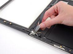 Schritt 38 -       Nehmen Sie das Digitizer-Bandkabel aus der Nische in den Aluminiumrahmen. Tun Sie dies mit Ihren Fingern.      Trennen Sie die Frontblende vom iPad.