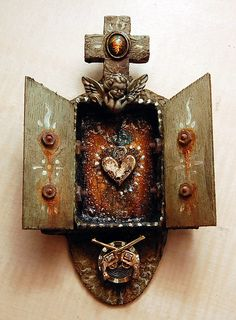 La Pistola y El Corazon by Julie Zarate,     paying homage to two of my favorite artists, Michael Demeng and George Yepes. this is a miniature matchbox nicho shrine with nod toward colonial mexican art and the whimsical.
