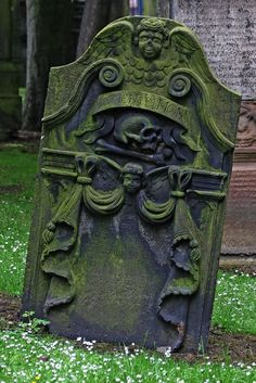 """One of the old gravestones to be found in the old churchyard. Below the skull carving are the words """"memento more"""" which are usually written as Momento Mori. Memento mori is a Latin phrase meaning """"Be mindful of death"""" and may be translated as """"Remember that you are mortal,"""" """"Remember you will die,"""" """"Remember that you must die,"""" or """"Remember your death""""."""